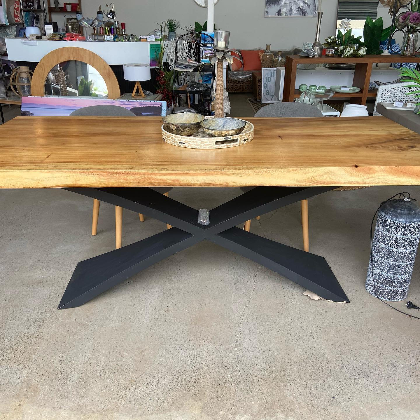 Beautiful timber table - solid carved Mango wood with elegant metal cross legs 210 x 94 cm. Come and have a look at Posh Lifestyle.